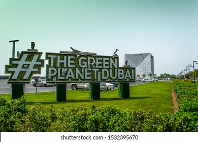 Dubai, City Walk #The green planet dubai - oct 02. 2019 Photo show the green planet Dubai sign at City walk mid day with a blue sky, the building itself in the back and greenery around the foreground.