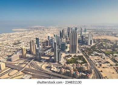 Dubai cityscape from Burj Khalifa at sunny morning, United Arab Emirates.