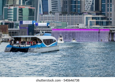 DUBAI - DECEMBER 17: Newly opened Dubai canal with boats and RTA ferry seen approaching Sheikh Zayed road bridge with falling water visible as seen on 17 December 2016.