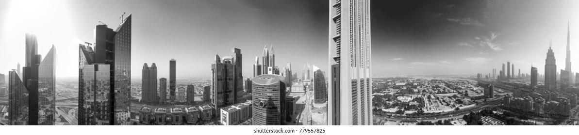 DUBAI - DECEMBER 2016: Aerial panoramic view of downtown city skyline. Dubai attracts 20 million tourists annually.