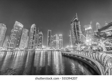 DUBAI - DECEMBER 2016: Marina buildings at sunset. Dubai attracts 15 million tourists annually.