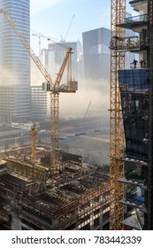 DUBAI - DECEMBER 2017: A foggy day in Business Bay with construction site and crane as seen on December 26, 2017.