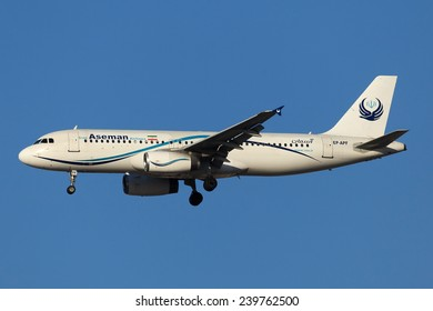 DUBAI - DECEMBER 24: Iran Aseman Airline's latest A320 addition to its fleet with a new scheme is landing at the Dubai International Airport as seen on December 24, 2014