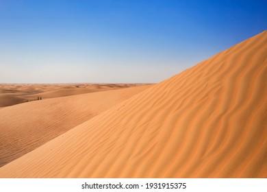 Dubai desert sand hills with wavy sand texture, nature background