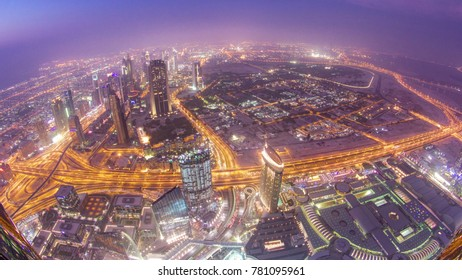Dubai downtown from day to night transition with city lights from Burj Khalifa timelapse, luxury new high tech town in middle East, United Arab Emirates architecture. View on sheikh zayed road 4K