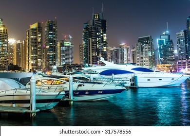 Dubai downtown night scene with city lights, luxury new high tech town in middle East. Dubai Marina cityscape, UAE.