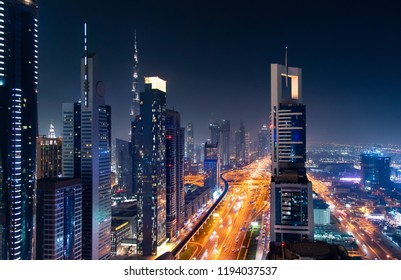 Dubai downtown night view with modern skyscrapers and busy traffic