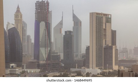 Dubai downtown skyline at cloudy morning timelapse with traffic on highway, UAE. Top view from rooftop of skyscraper with modern towers near Al Saada street
