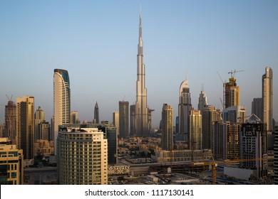 Dubai Downtown skyline. Futuristic cityscape. Burj Khalifa the tallest building in the world. Dubai skyscrapers. Sunrise morning time. Dubai construction. Modern city panorama.
