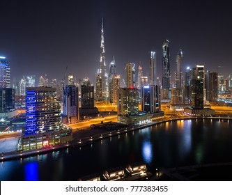 Dubai Downtown skyline. Night cityscape. Burj Khalifa tallest building in the world. Skyscraper construction. Dubai iconic view. Business bay towers. Dubai Canal. Futuristic city. City lights.