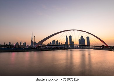 Dubai Downtown skyline over the water canal at sunrise. Dubai, UAE.
