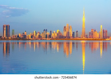Dubai downtown view with reflection  from the Dubai Creek at sunrise, United Arab Emirates
