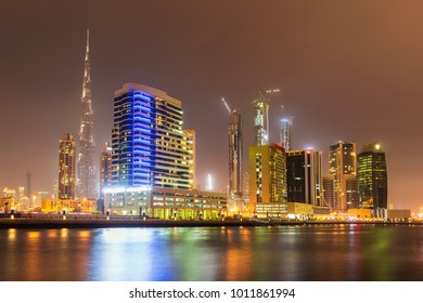 Dubai downtown and water canal with promenade after the sunset,Dubai, United Arab Emirates