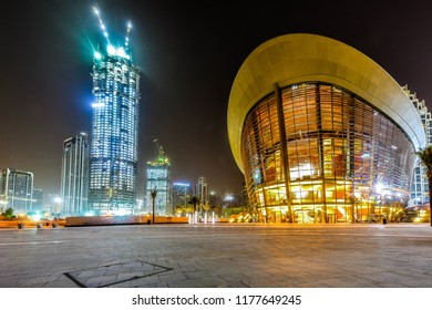 Dubai, Dubai/UAE - Sept 12, 2018: Opera house and Burj Khalifa at night Dubai, UAE