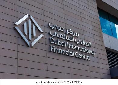 """Dubai, Dubai/United Arab Emirates - 1/25/2020: Dubai International Financial Centre (DIFC) sign and icon on a financial building in downtown modern dubai full of skyscrapers."""