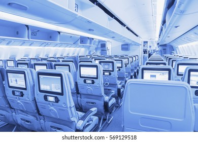 DUBAI, EMIRATES - MARCH 14, 2016:  Boeing 777 EMIRATES, Interior Economy class with TV Touch screen in Emirates Airlines in Dubai Airport.