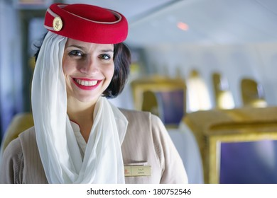 DUBAI - FEB 13: Emirates crew member in Boeing 777-300ER aircraft on February 13, 2013 in Dubai, UAE. Emirates handles major part of passenger traffic and aircraft movements at the airport.