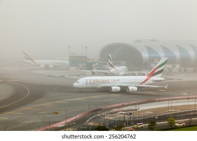 DUBAI - FEBRUARY 21: Emirates A380 is taxiing for take off in a sand storm not in a foggy day as seen on February 21, 2015.