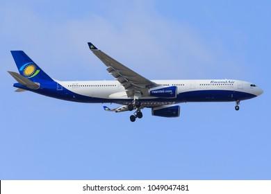 DUBAI - FEBRUARY 26: A Rwanda Air aircraft is landing at DXB airport as seen on February 26, 2018.