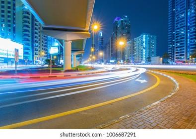 DUBAI FINANCIAL CENTER,UNITED ARAB EMIRATES-FEBRUARY 13, 2017: Busy Sheikh Zayed Road, metro railway and modern skyscrapers around in luxury Dubai city,United Arab Emirates