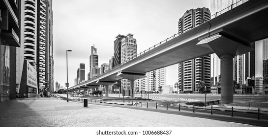 DUBAI FINANCIAL CENTER,UNITED ARAB EMIRATES-FEBRUARY 13, 2017: Busy Sheikh Zayed Road, metro railway and modern skyscrapers around in luxury Dubai city,United Arab Emirates