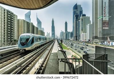 DUBAI FINANCIAL CENTER,UNITED ARAB EMIRATES-FEBRUARY 25, 2016: Financial Center and metro railway in luxury Dubai,United Arab Emirates