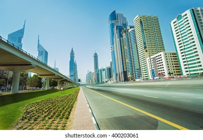 DUBAI FINANCIAL CENTER,UNITED ARAB EMIRATES-FEBRUARY 25, 2016: View on highway and metro line in Financial Center of luxury Dubai city,United Arab Emirates