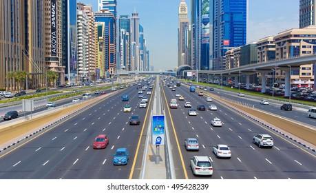 DUBAI FINANCIAL CENTER,UNITED ARAB EMIRATES-FEBRUARY 28, 2016: Busy Sheikh Zayed Road, metro railway and modern skyscrapers around in luxury Dubai city,United Arab Emirates