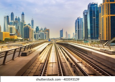 DUBAI FINANCIAL CENTER,UNITED ARAB EMIRATES-MARCH 5, 2016: Modern skyscrapers and Dubai Metro-driverless,fully automated rail network, carry over 200,000