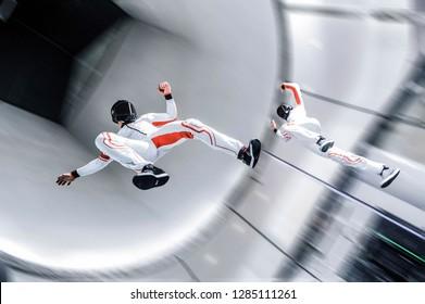 Dubai. flying people in wind tunnel . indoor skydiving