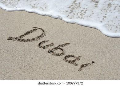 Dubai handwritten in sand for natural, symbol,tourism or conceptual designs