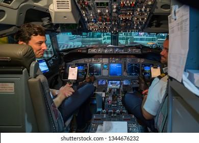 DUBAI INTERNATIONAL AIRPORT, DUBAI, UNITED ARAB EMIRATES - JANUARY 26, 2016: Captain pilot and co-pilot in the  Flight Deck cockpit of Boeing 747.