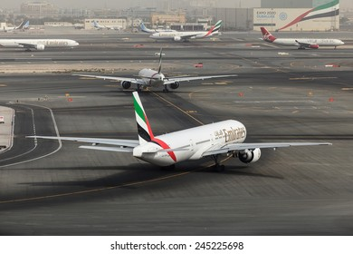 DUBAI - JANUARY 9: An Emirates plane is taxing for take off as seen on January 9, 2015. Dubai airport's traffic is very heavy in the mornings as can be see here planes are queuing up for departure.
