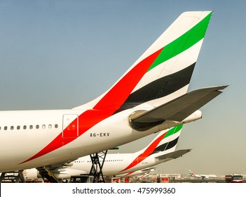 DUBAI - JULY 2008: Emirates airplane at Dubai airport. Emirates is one of the biggest travel companies in the world.