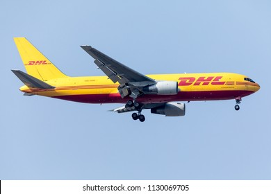 DUBAI - JULY 8: A DHL aircraft is landing at DXB airport as seen on July 8, 2018.