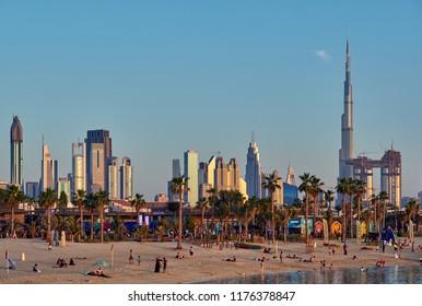 DUBAI - MARCH 26, 2018: Dubai sunset skyline and La Mer beach in United Arab Emirates