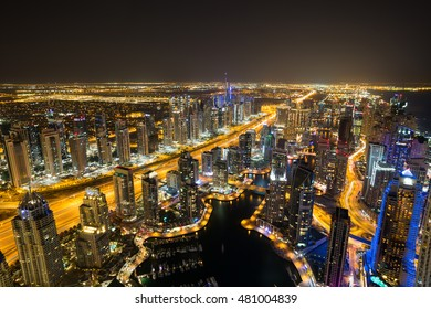 Dubai Marina by night. Dubai aerial view. Dubai skyscrapers. Rooftop view. Dubai luxury homes. Dubai Emaar properties buildings. Jumeirah lakes towers. Dubai skyline. Night cityscape.Sheikh Zayed road