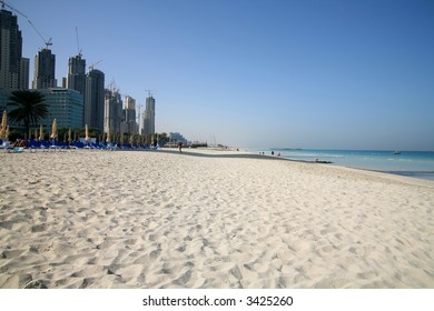 Dubai Marina complex under construction by beach