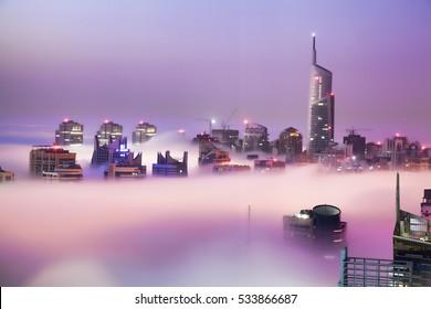 Dubai Marina is covered by early morning fog in Dubai, United Arab Emirates