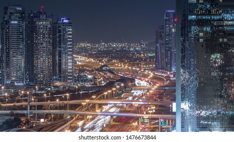 Dubai Marina and JLT aerial night timelapse top view of skyscrapers in Dubai, UAE. Modern towers and traffic on sheikh zayed road and metro line