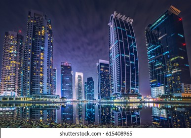 Dubai Marina jumeirah buildings at evening front of the lake. beautiful night and lights