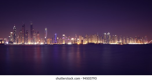 Dubai Marina in the night. Panoramic view from gulf