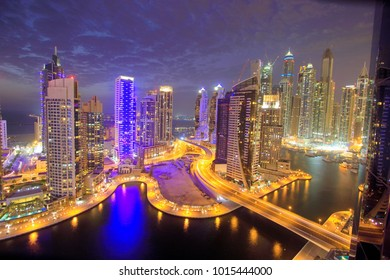 Dubai marina with skyscraper view in sunset, blue time.
