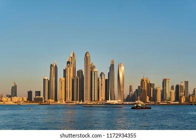 Dubai marina sunset skyline in United Arab Emirates
