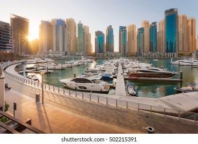 Dubai Marina Sunset in a sunny day with a Beautiful view of dubai marina towers and walk