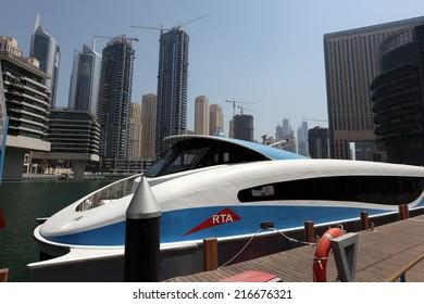 DUBAI MARINA, UAE - MAY 28: Modern ferry boat in Dubai Marina. May 28, 2011 in Dubai, United Arab Emirates