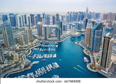 DUBAI MARINA,UNITED ARAB EMIRATES-FEBRUARY 14, 2017: View on Dubai Marina skyscrapers and the most luxury super yacht marina,Dubai,United Arab Emirates