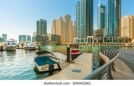 DUBAI MARINA,UNITED ARAB EMIRATES-FEBRUARY 28, 2017: Dubai marina with luxury yachts and skyscrapers, Dubai, United Arab Emirates