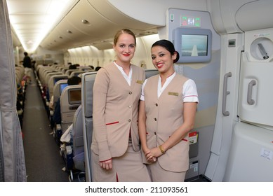 DUBAI - MAY 16: Emirates crew members in Airbus A380 aircraft on May 16, 2014 in Dubai, UAE. Emirates handles major part of passenger traffic and aircraft movements at the airport.