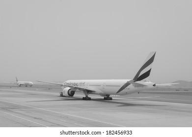 DUBAI - MAY 23: Emirates flights at Dubai Airport on May 23, 2012 in Dubai, UAE. Emirates handles major part of passenger traffic and aircraft movements at the airport.